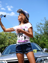 Japanese teen in shorts washing car outside - part 3338