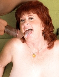 Older redhead Shirley Lily takes a captured mans spunk fountain in her mouth