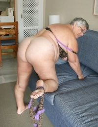 Fat fatty granny baring her saggy boobs & opening up her nasty beaver broad open