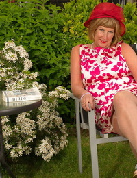 Horny mature British woman in pantyhose wanking in the garden