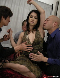 Japanese lady Maria Ozawa has her pussy pleasured by many men at once