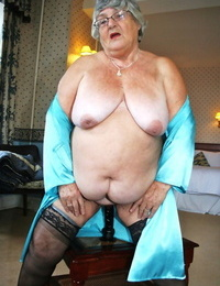 Old lady with a saggy tits and a fat stomach delights herself with a fake penis
