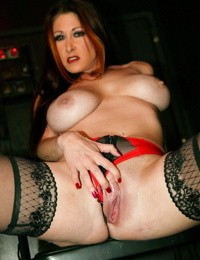 Busty female Tiffany Mynx works two gloryholes at the same time