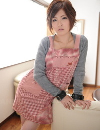 Japanese beauty Kaede Oshiro is silenced after being handcuffed while dressed