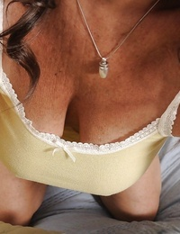 Black-haired granny Tia participates in an undressing scene- showing her tits